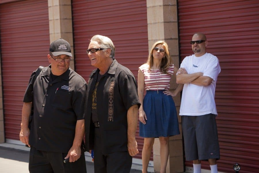 Brandi Passante and Jarrod Schulz were standing behind Dave Hester and Barry Weiss in front of some storage units.