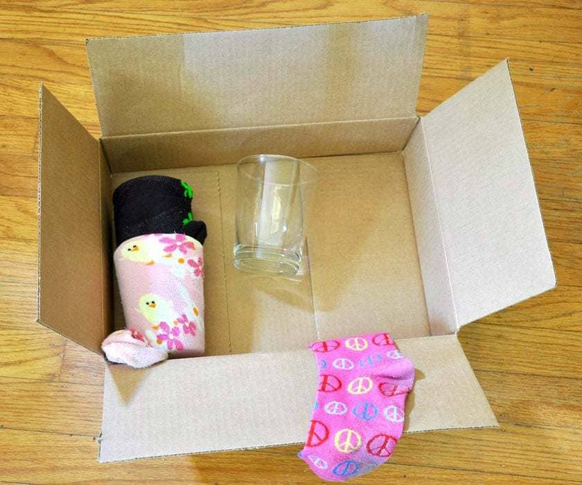 A box filled with valuables stuff wrapped in a sock