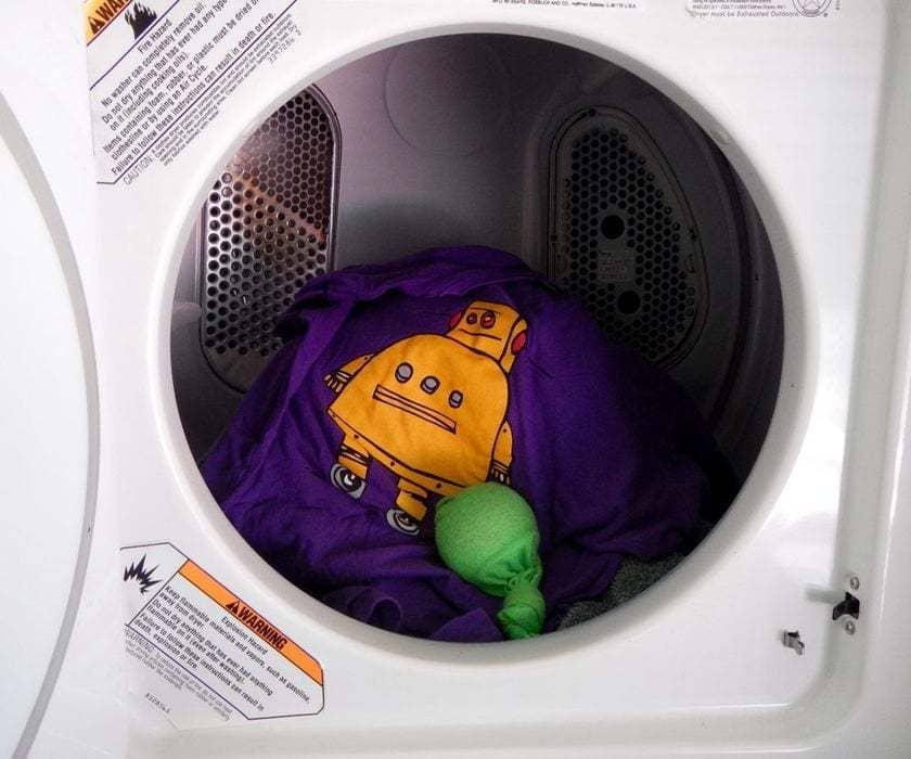 A dryer ball inside a washing machine