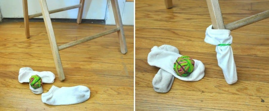 Socks covering legs of a chair