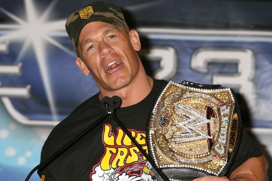John Cena holding his WWE championship belt