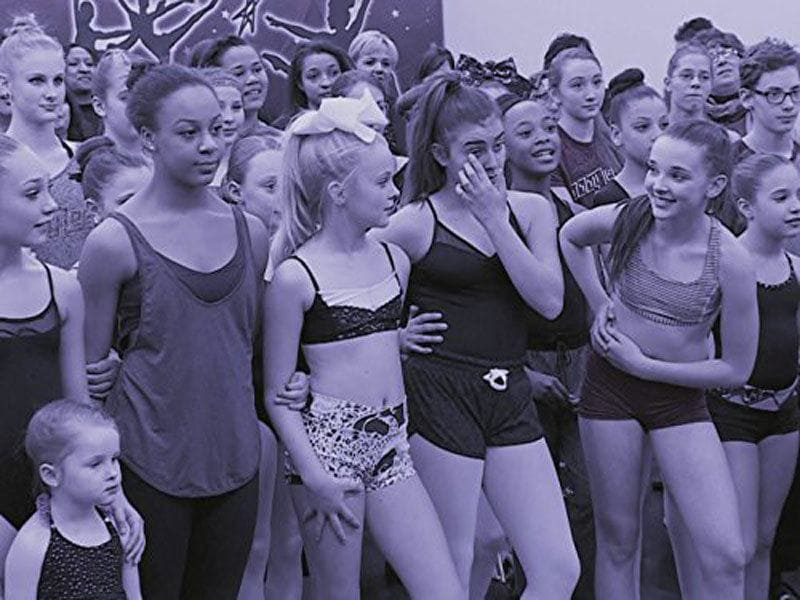 Maddie Ziegler, Nia Sioux, Kalani Hilliker, Kendall Vertes, and JoJo Siwa, the original crew, surrounded by other dancers.