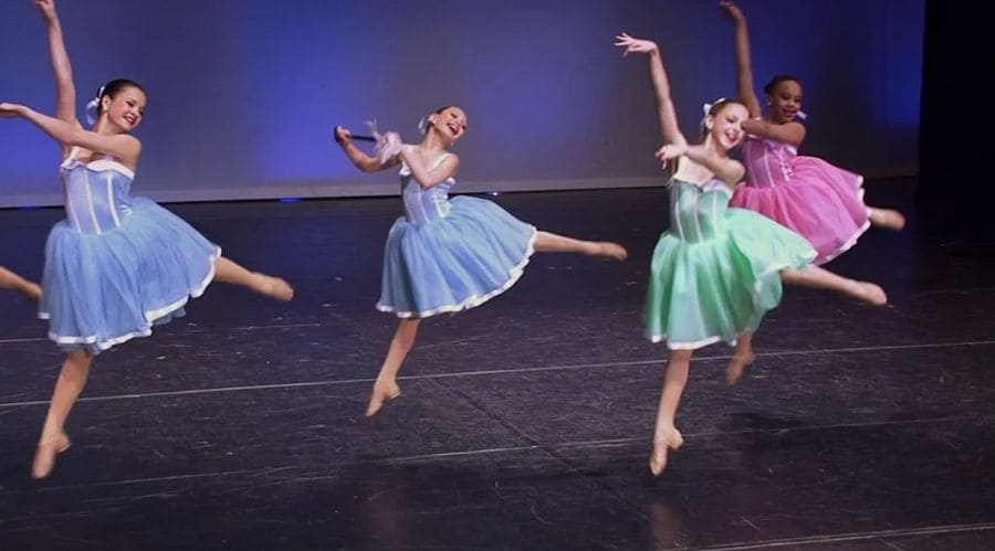 The girls of Dance Moms are performing Silver Spoons in puffy short dresses.