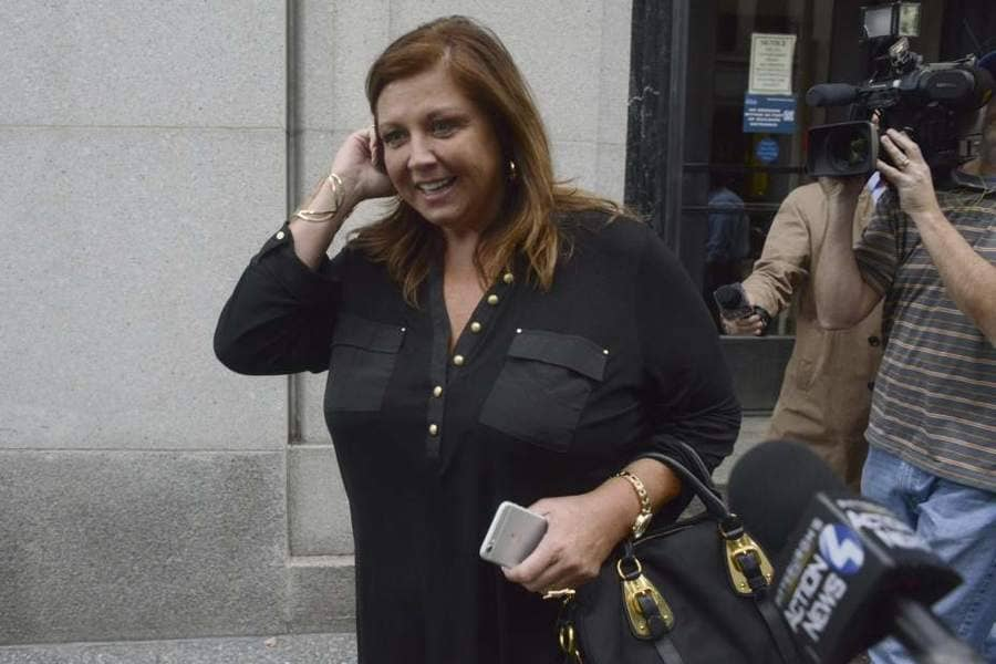 Abby Lee Miller is outside of the courthouse being followed by the news.