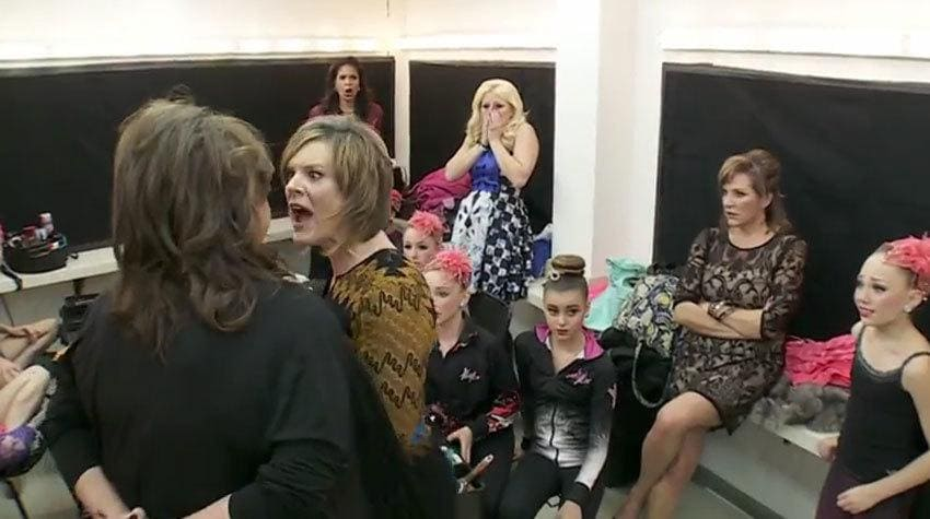 Abby Lee and Kelly mid-fight with everyone shocked around them.