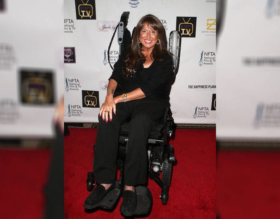 Abby Lee Miller is posing in her wheelchair at the National Film and Television Awards in 2018.