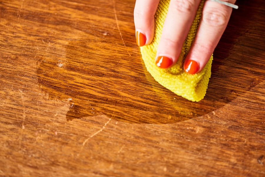 Cleaning a wooden table
