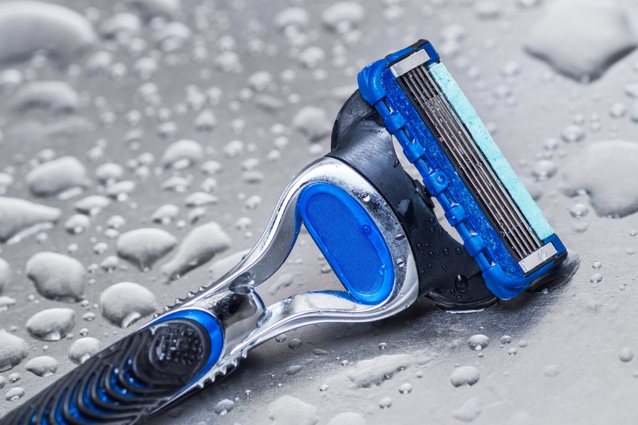 wet disposable razor isolated. Close-up