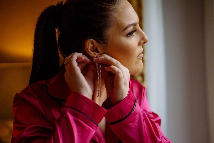 Women putting on an earring