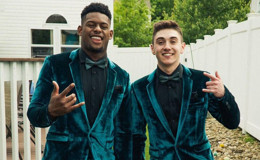 Juju Smith-Schuster and Anthony Molinaro dressed for prom in matching teal suits