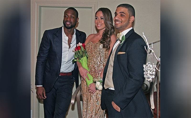 Dwayne Wade, Nicole Muxo, and Laurent Chaumin, her actual prom date