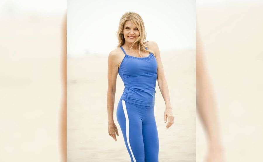 Kathy Smith in a blue workout top and matching pants with a white stripe