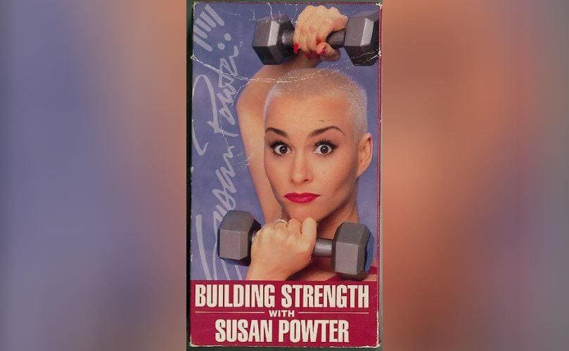 Susan Powter holding weights and looking straightforward with 'Building Strength with Susan Powter' written underneath it