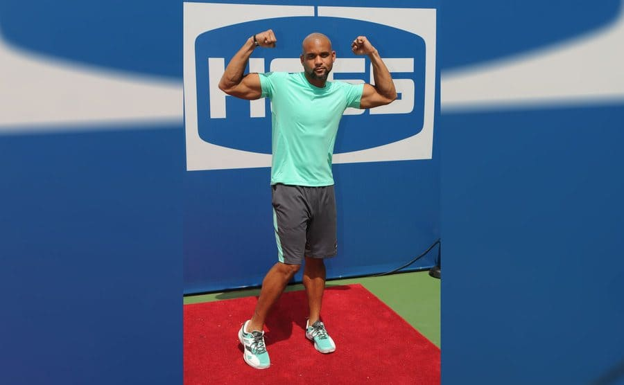 Shaun T flexing his muscles in 2015