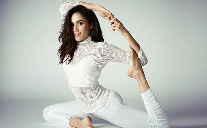Meghan Markle doing a version of yoga's pigeon posture, or mermaid pose