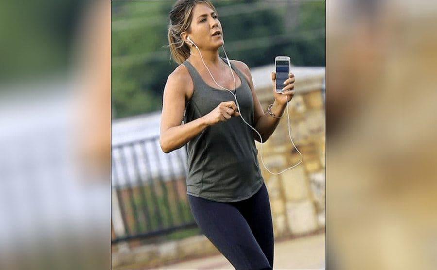 Jennifer Aniston out running