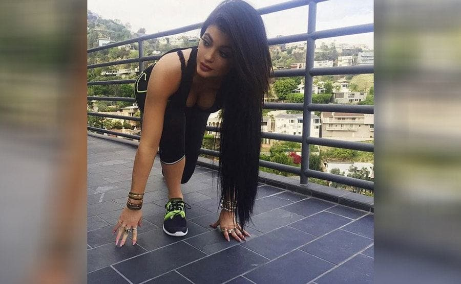 Kylie Jenner in a pose that looks like she's about to start running