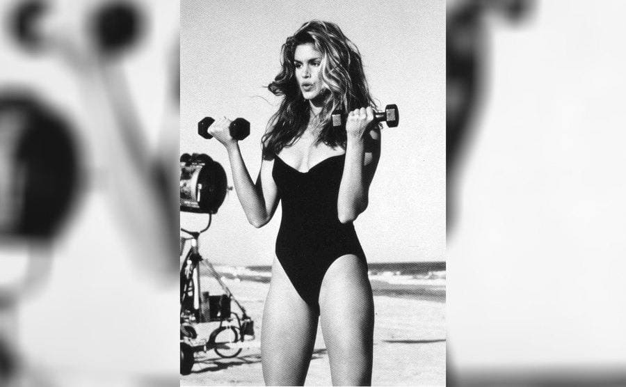 Cindy Crawford holding weights working out