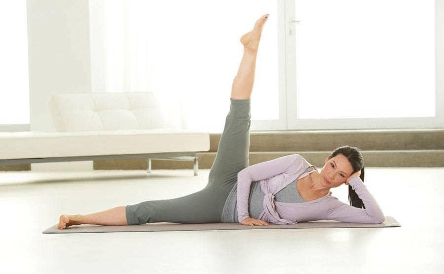 Lucy Liu doing Pilates
