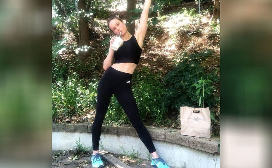 Brie Larson with a shake from shake shack after a morning run