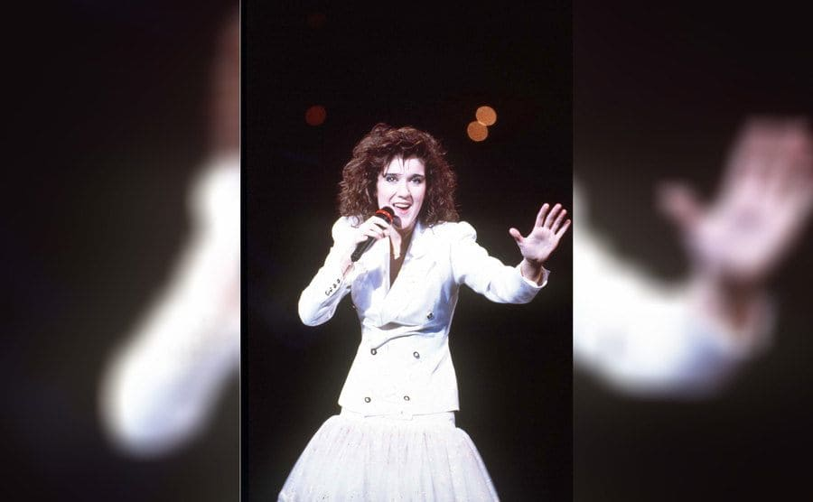 Celine Dion was performing in a white suit jacket with a puffy lace skirt in 1988.