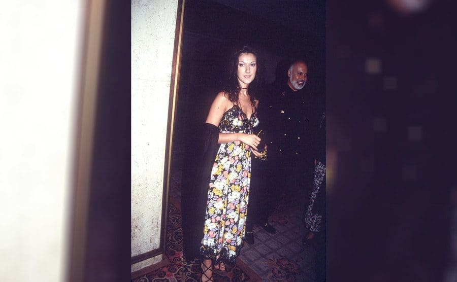 Celine Dion with Rene Angélil in the background, June 1993.