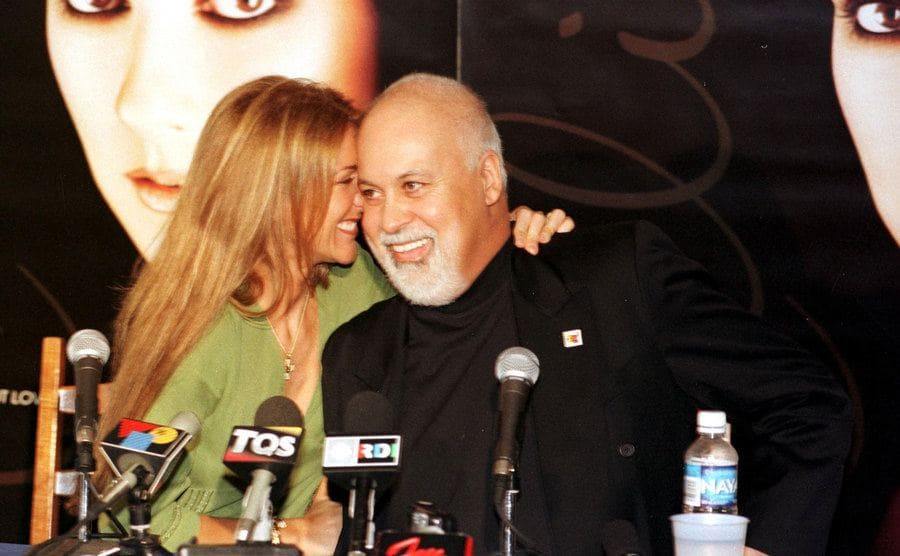 Celine Dion and Rene Angélil are excited at a press conference in Canada in 1999.