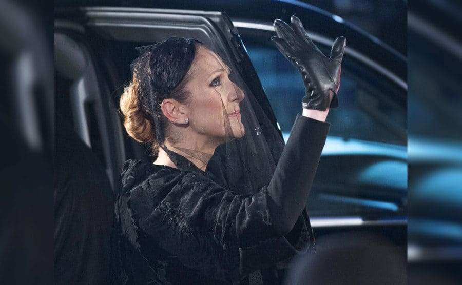 Celine Dion waves goodbye to her late husband after the funeral services for Rene Angélil were held at Notre-Dame Basilica, January 22nd, 2016.