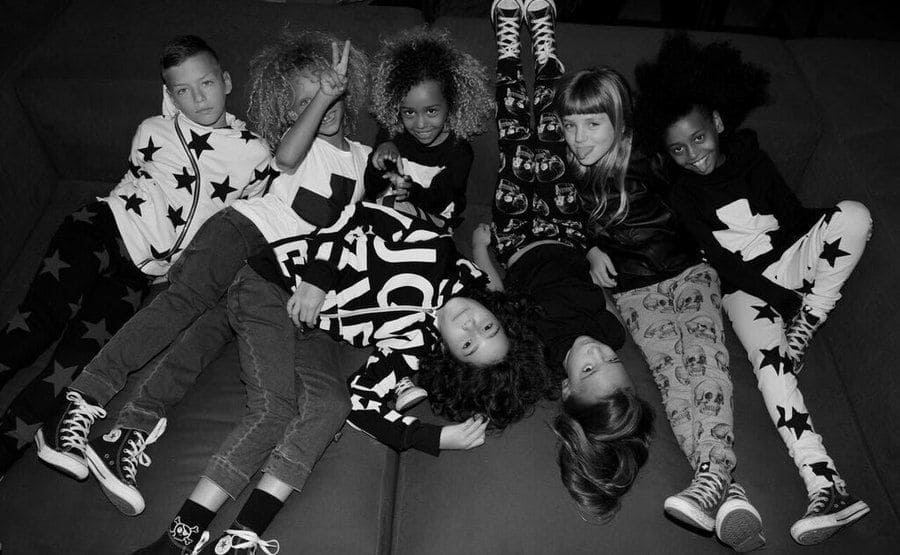 A photograph of child models wearing the clothing from the NUNUNU fashion line.