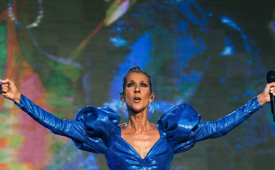 Celine Dion was performing in a blue dress with puffy shoulders.
