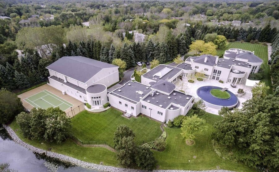 Michael Jordan's home photographed from an aerial viewpoint with a basketball court on the left side