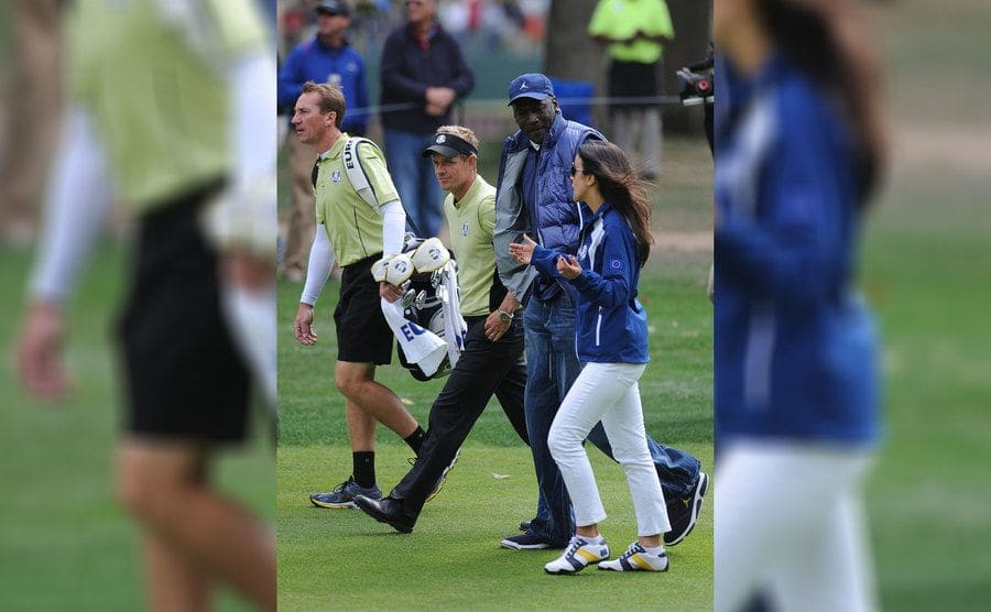 Michael Jordan walking and talking with Luke Donald and his wife in 2012