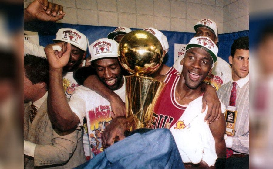 Michael Jordan celebrates with his teammates as the Bulls won their third NBA title on June 20th, 1993