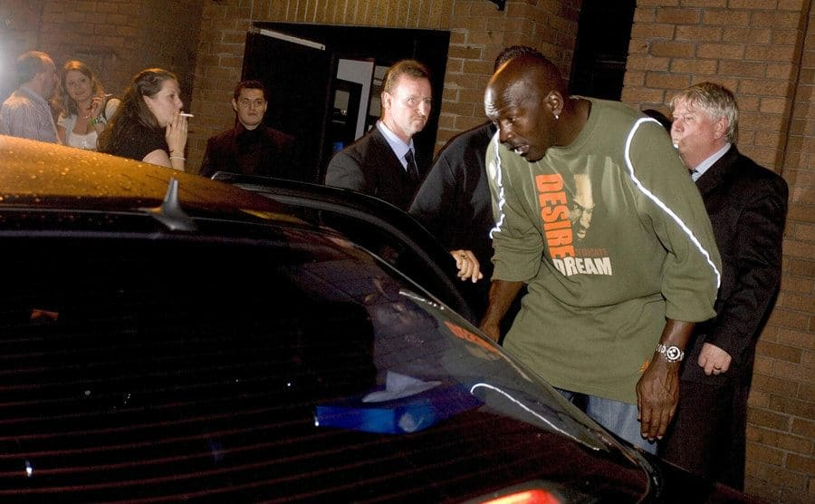 Michael Jordan leaving a nightclub about to get in his car