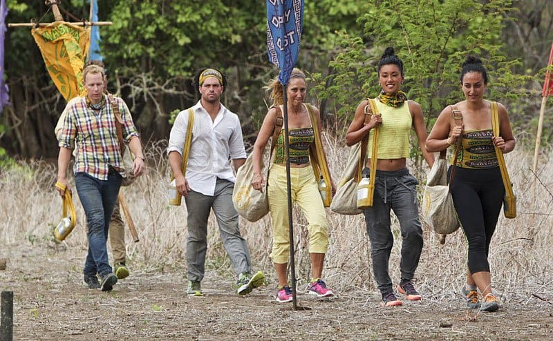 The yellow tribe walking with sacks