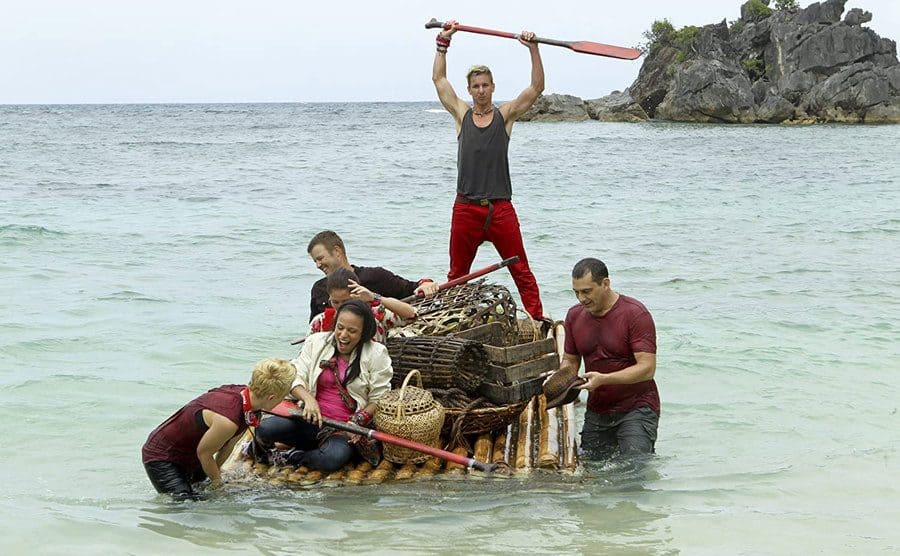 Contestants on a raft in the ocean on Survivor