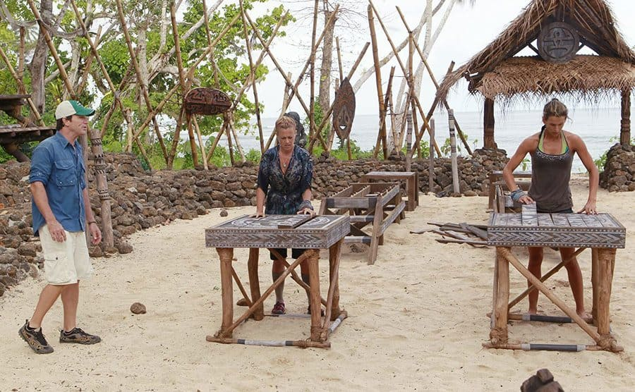 Jeff Probst hosting while Christine Shields Markoski and Mikayla Wingle compete in Survivor