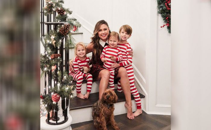 Photo of Vanessa Lachey and her children and their dog on the stairs