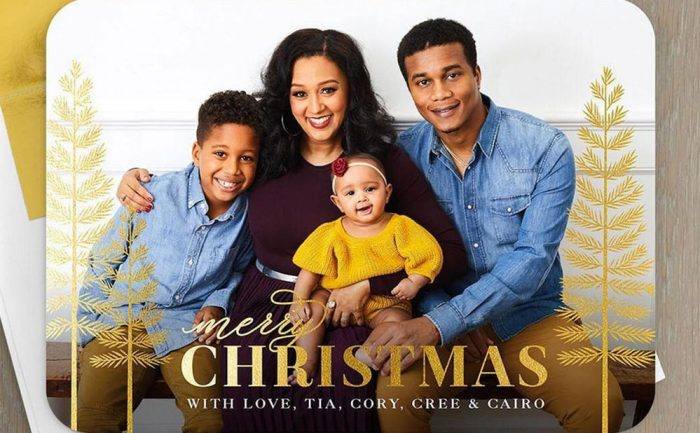 holiday card of Tia Mowry, her husband, Cory Hardrict, and their kids