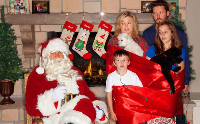 photo of Kelly Clarkson and her family with Santa Clause in front of the fireplace