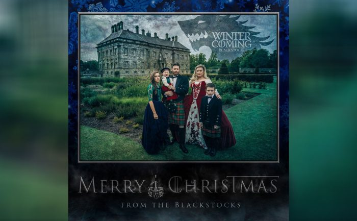 holiday card of Kelly Clarkson and her family in the style of Game of Thrones