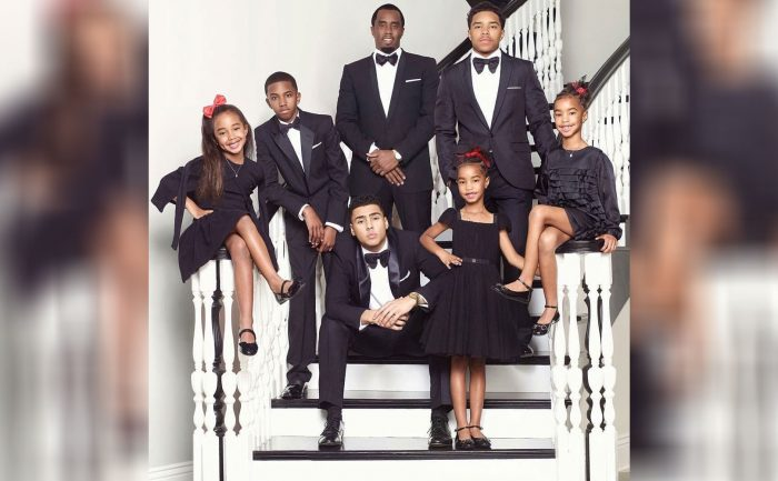 Sean Combs and his children in formal attire on the staircase
