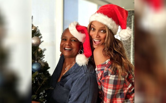 Tyra Banks and Her mother in Santa hats