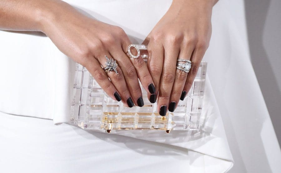 Camila Alves's hands full of rings, including her engagement ring