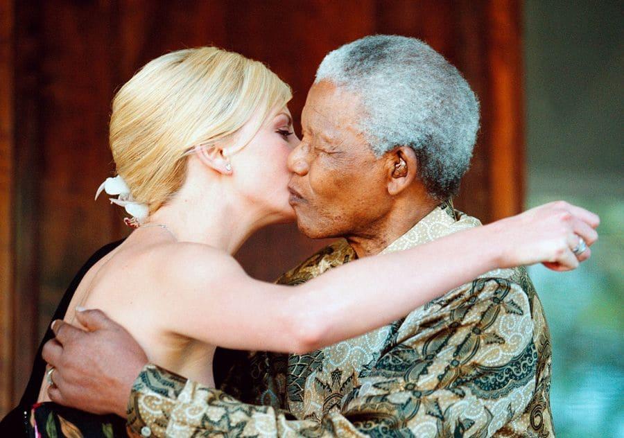 June 2001, Charlize Theron, embraces Nelson Mandela.