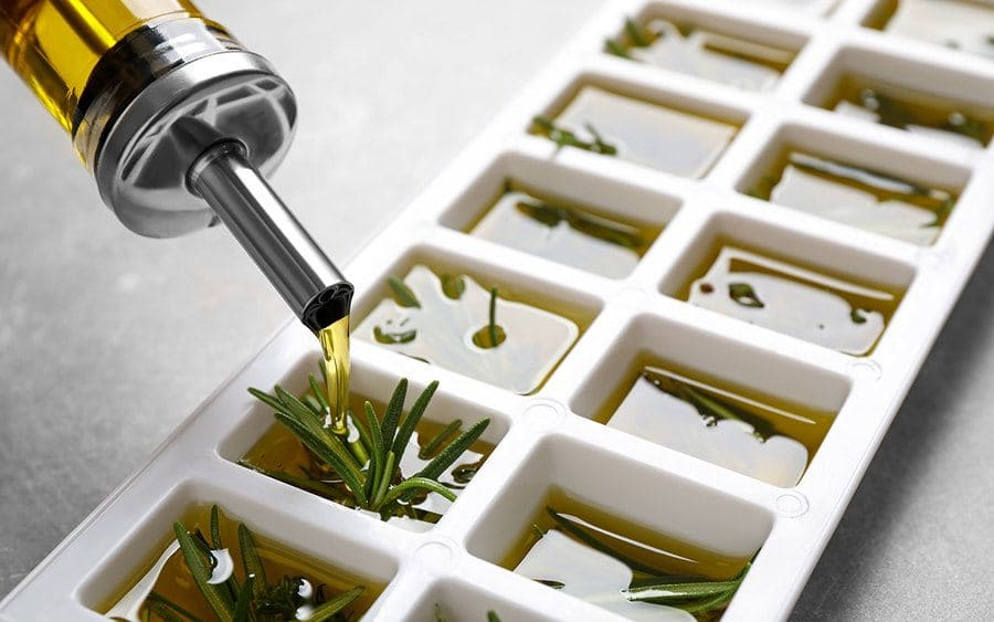 Frozen herb and oil ice cubes