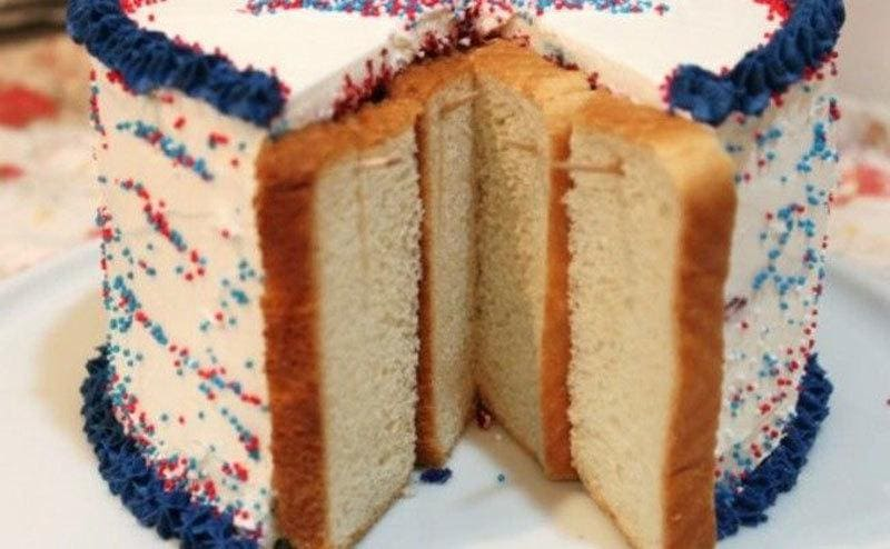 Slices of bread are placed over the exposed parts of a cake