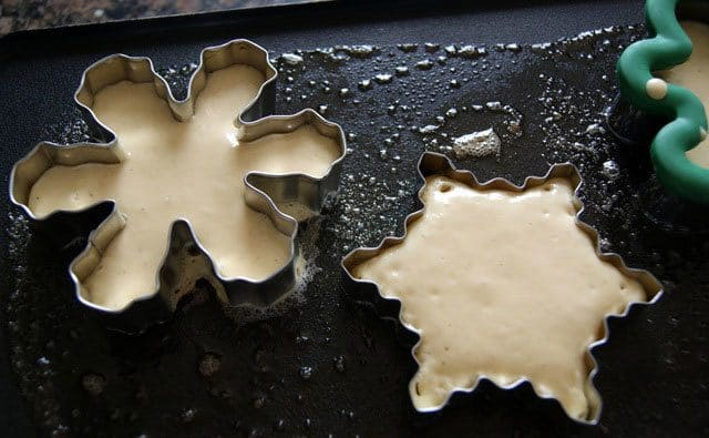 Cookie cutters being used to make different shaped pancakes