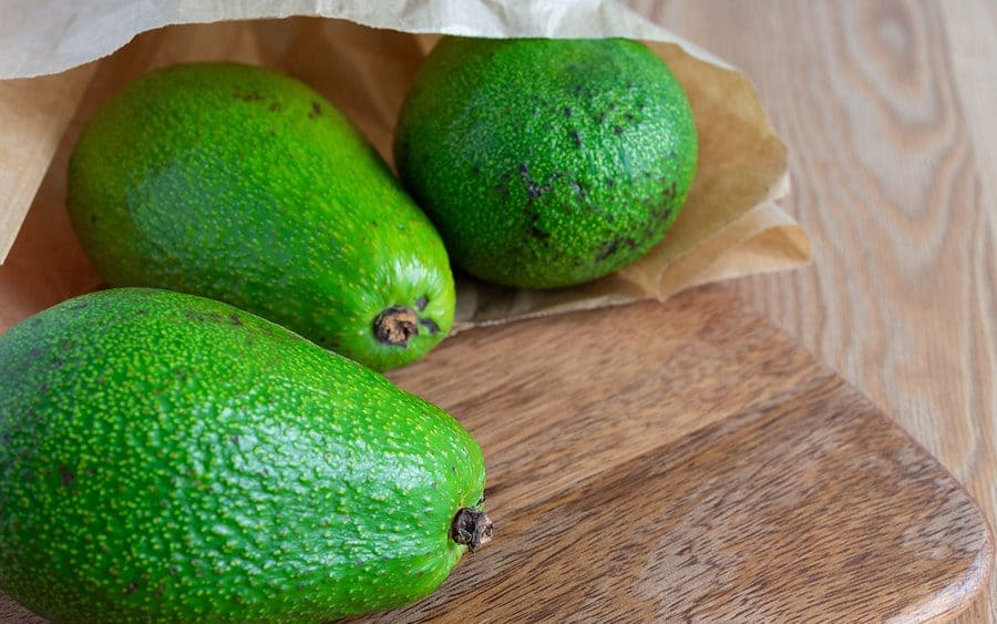 Avocados in a paper bag