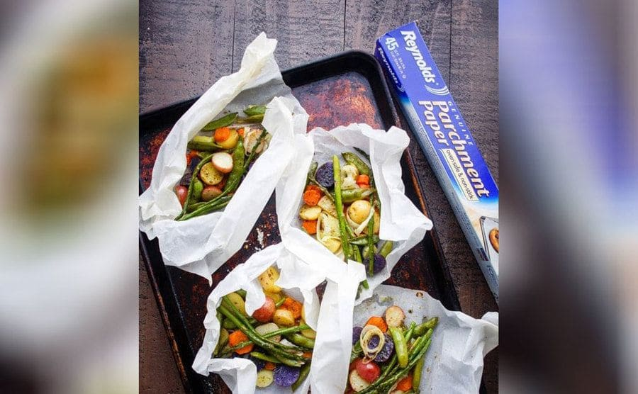 Vegetables in parchment paper bags